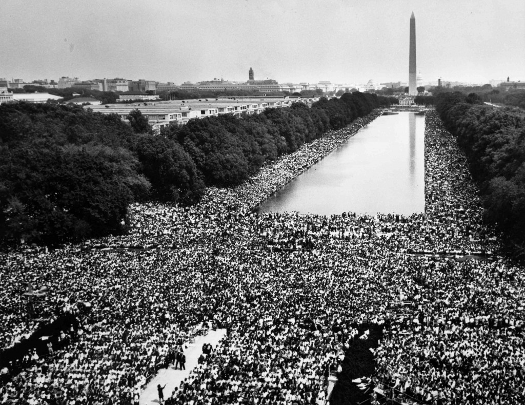 """Hundreds of thousands of marchers gather around the reflecting pool in front of the Washington monument and listen as the Rev. Martin Luther King Jr. delivers his """"I Have A Dream"""" speech from the steps of the Lincoln Memorial during the March on Washington for Jobs and Freedom in this August 28, 1963 file photo shot by U.S. Information Agency photographer Rowland Scherman and provided to Reuters by the U.S. National Archives in Washington on August 21, 2013. In the coming week, Washington will play host to an array of events marking the 50th anniversary of the march and speech. REUTERS/Rowland Scherman/U.S. Information Agency/U.S. National Archives (UNITED STATES - Tags: POLITICS ANNIVERSARY) ATTENTION EDITORS - THIS IMAGE WAS PROVIDED BY A THIRD PARTY. FOR EDITORIAL USE ONLY. NOT FOR SALE FOR MARKETING OR ADVERTISING CAMPAIGNS.THIS PICTURE IS DISTRIBUTED EXACTLY AS RECEIVED BY REUTERS, AS A SERVICE TO CLIENTS"""