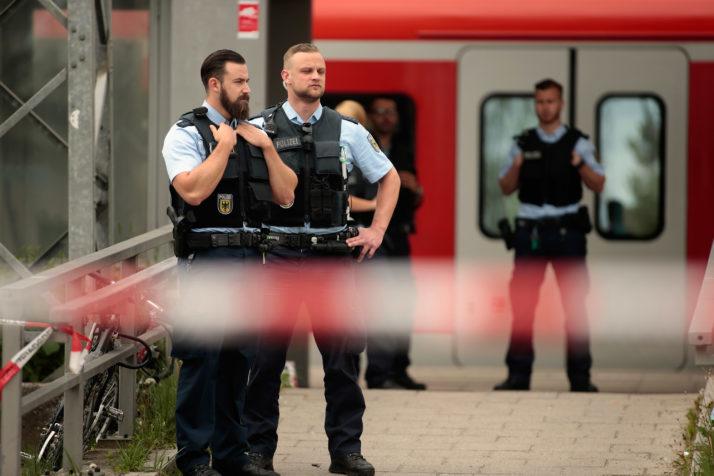 GRAFING, GERMANY - MAY 10: Riot police secures the crime scene after a deadly knife attack on May 10, 2016 in Grafing, Bavaria. One person has died and three others have been injured after a man launched a knife attack at Grafing commuter train station that police prosecutors said had 'an apparent Islamist motive'. (Photo by Johannes Simon/Getty Images)