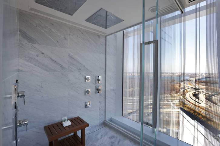 The two-person shower in a 23rd floor suite has a view that includes most of Washington, and Alexandria, Va., as seen during a preview tour of the MGM National Harbor, Friday, Dec. 2, 2016 in Oxon Hill, Md. The $1.4 billion National Harbor casino and resort, just outside the nation's capital, is scheduled to open December 8th. (AP Photo/Alex Brandon)